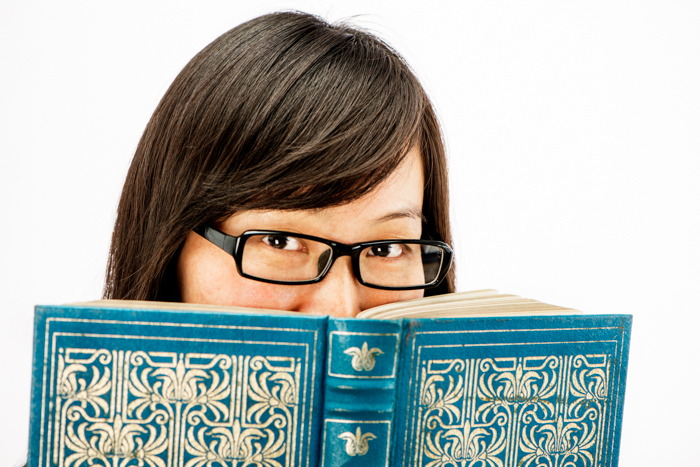 Asian woman with an old book - photography props
