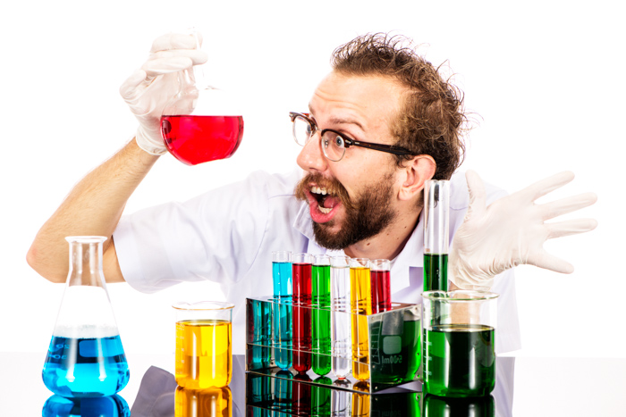 Frustrated mad scientist with chemicals in the lab - photography props