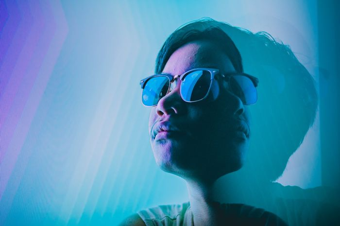 Portrait of a guy in sunglasses with prism photography effect