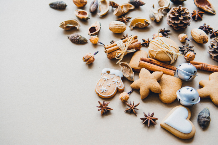 christmas themed flatlay with bells, acorns, and cookies