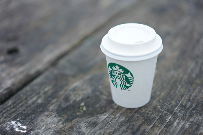 starbucks cup on a grey wood surface