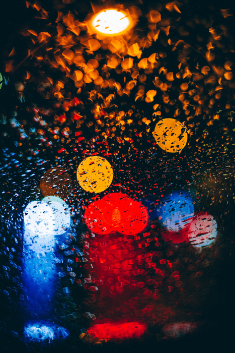 Abstract rain photography shot of coloured bokeh lights