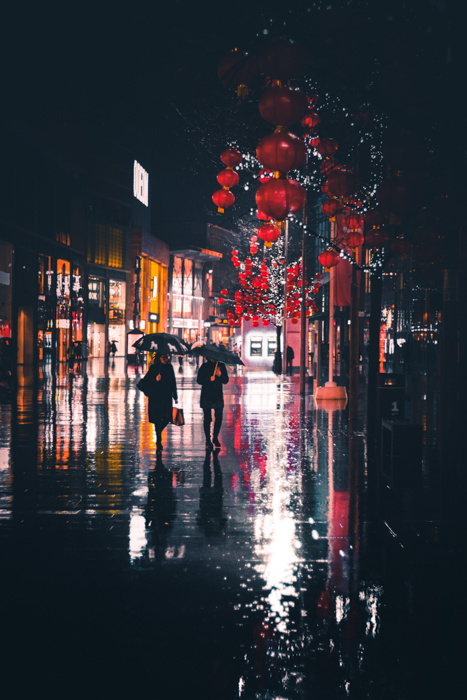 Atmospheric rain photography of a city street at night