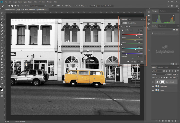 A screenshot of editing a photo of parked yellow van in Photoshop. adjustment layer applied, moving sliders to adjust tones further