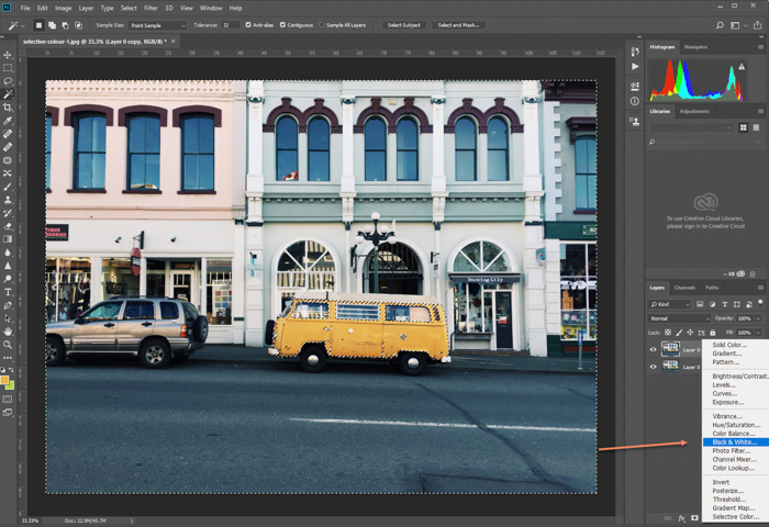 A screenshot of editing a photo of parked yellow van in Photoshop. selecting black and white adjustment layer