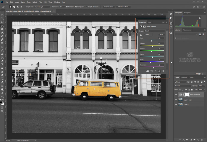A screenshot of editing a photo of parked yellow van in Photoshop. adjustment layer applied, adjusting tones