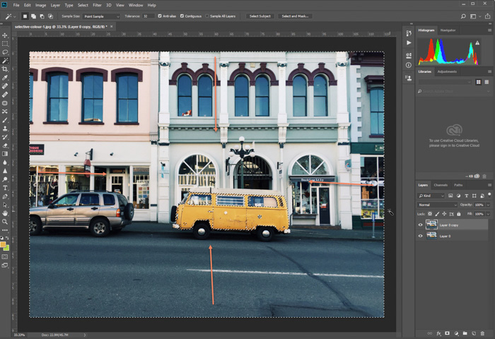 A screenshot of editing a photo of parked yellow van in Photoshop. inverse selected
