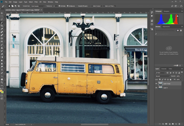 A screenshot of editing a photo of parked yellow van in Photoshop. using magic wand to select colour