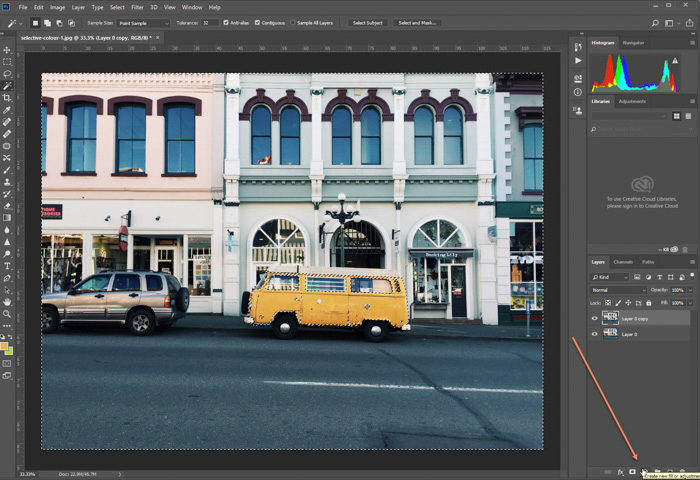 A screenshot of editing a photo of parked yellow van in Photoshop. adding adjustment layer