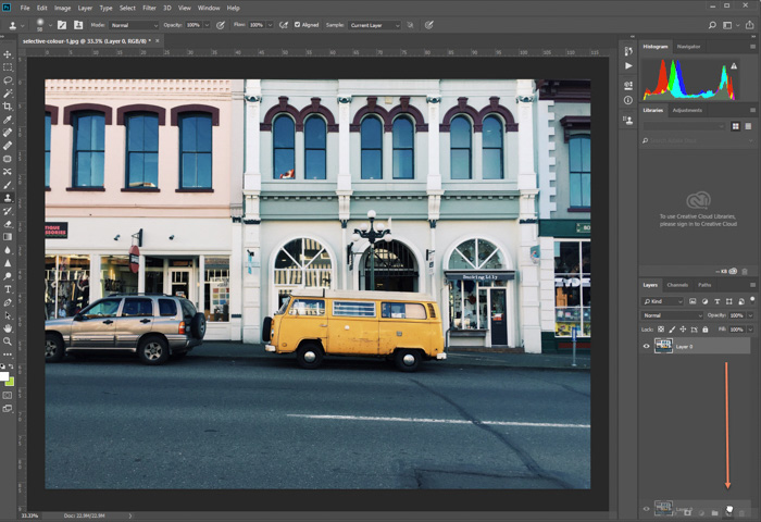 editing photo of parked yellow van in Photoshop . making a copy