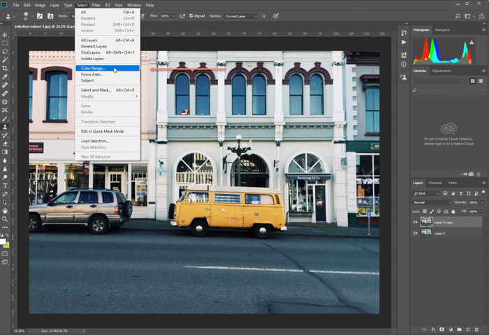 editing photo of parked yellow van in Photoshop. Selecting color range option using selective color photoshop