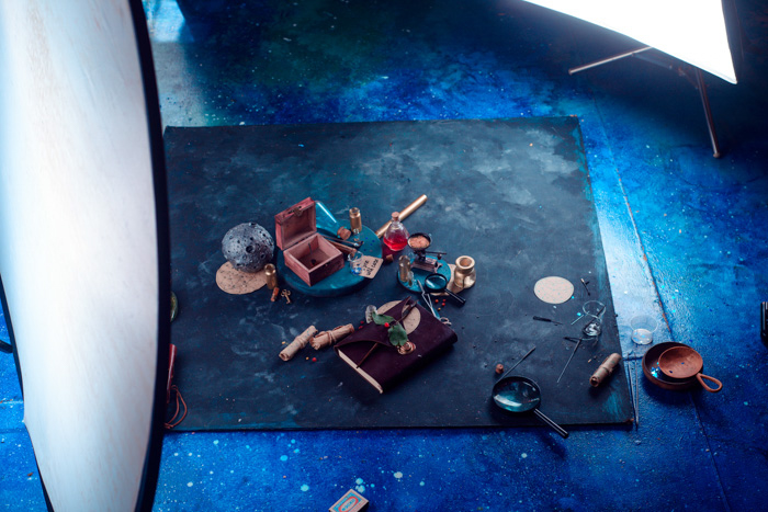 angled view of background board, wood box and other items in flatlay being prepared for a sparkler photography shot