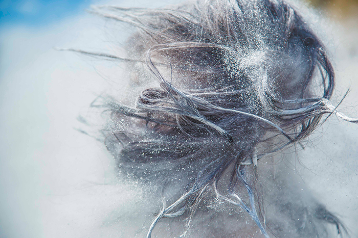 Abstract portrait featuring flying hair and flour - cool texture photography
