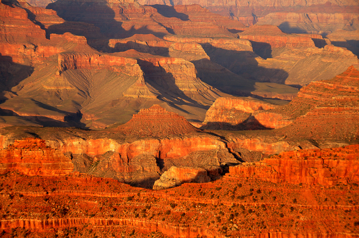 A vast canyon of red sedimentary rock - travel the world photography.