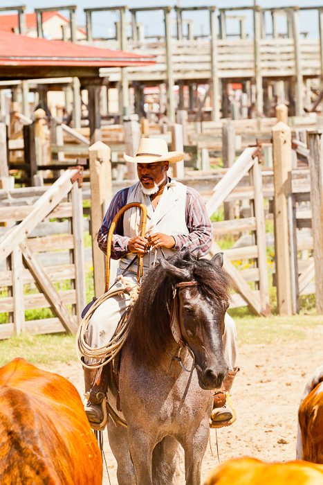 man in a cowboy hat riding a horse