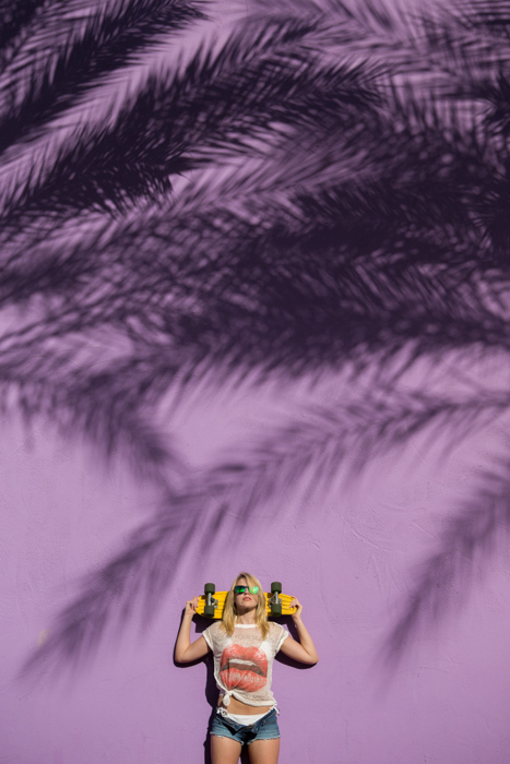 A fashion photography shot featuring strong use of complementary colors yellow and purple