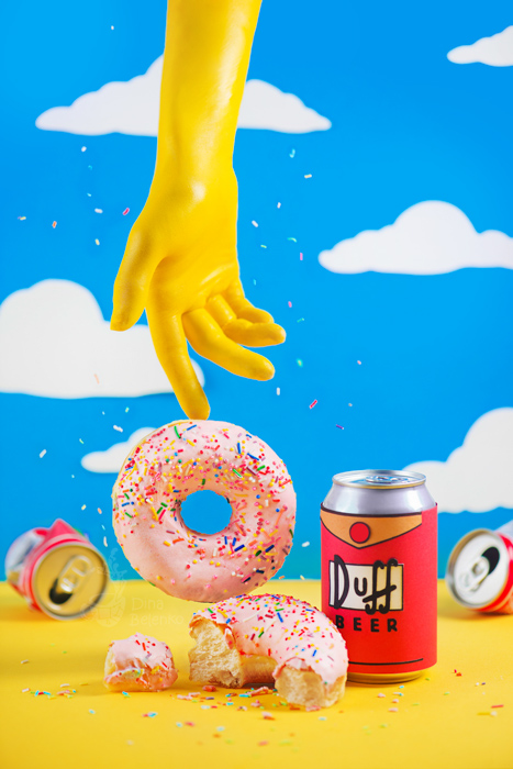 A Simpson themed still life photography shot featuring contrasting colors blue and yellow