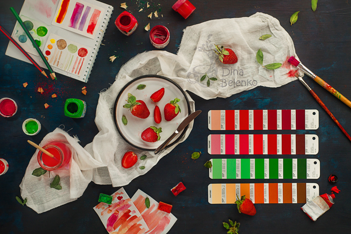 A flat lay photo themed with red and green complementary colors
