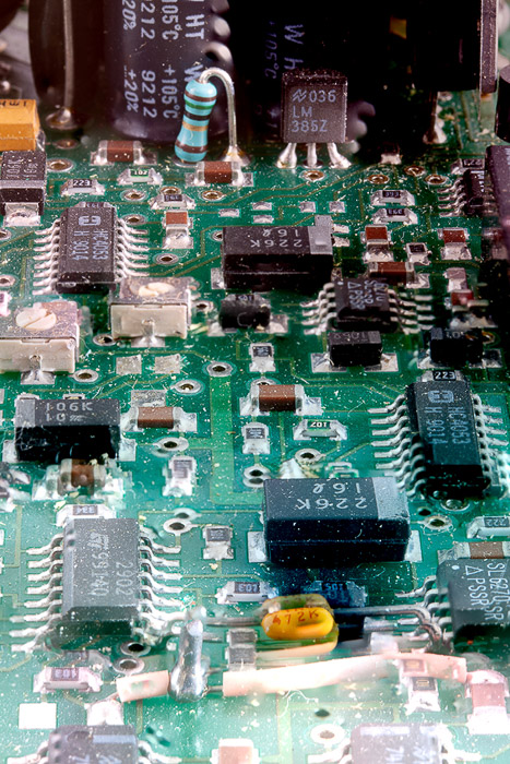 A very poor result of focus stacking a macro shot of a circuit board, the result of forgetting to align images before blending.