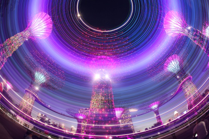 A light painting photo of supertrees in Singapore