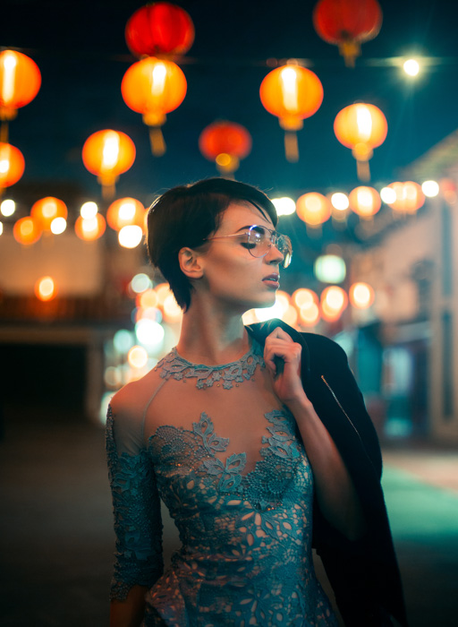 A photo of a female model posing in the street at night, before adding photoshop textures