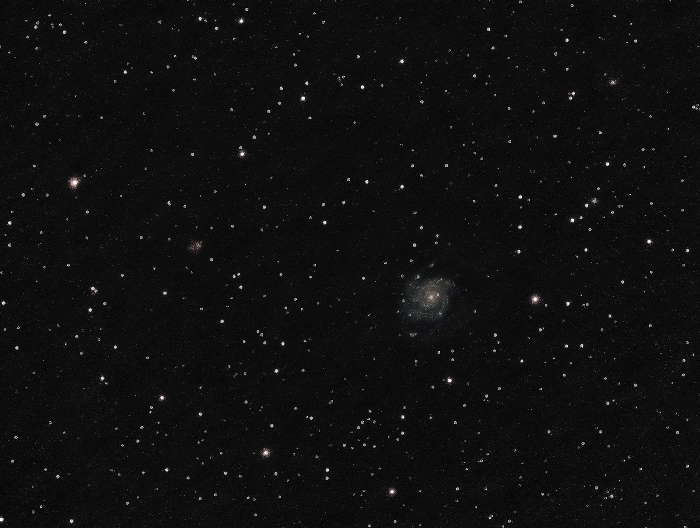 A great astrophotography composition shot of M51, also known as Whirlpool Galaxy in the Ursa Major constellation.