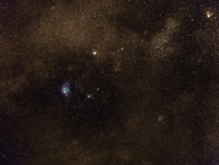 Lagoon and Trifid Nebulae in conjunction with Saturn (above them). On the top-right corner another nebula, the Omega Nebula.