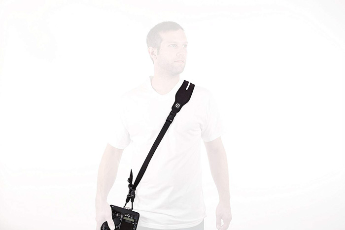 Image of a person with the Custom SLR Glide - best camera strap options