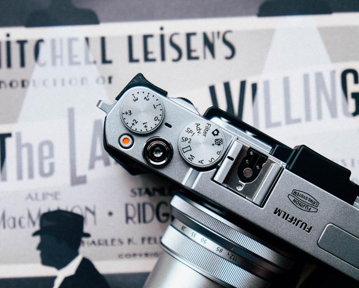 An overhead shot of a fujifilm camera - fuji lenses
