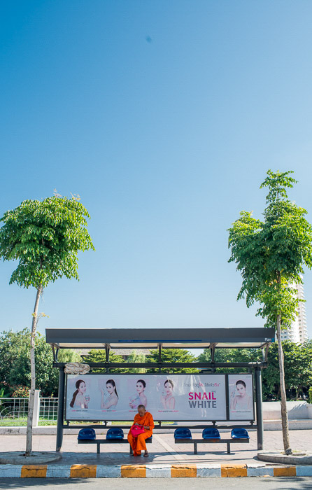 Bright and airy outdoor photo of a bus stop using natural light photography