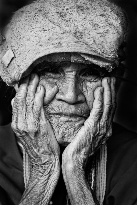 A black and white portrait of an Old Karen Woman
