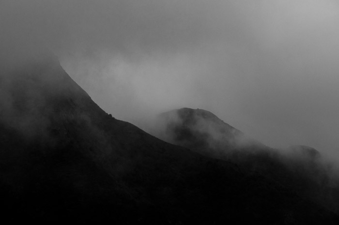 Black and white fine art landscape Foggy mountains in Hong Kong, China.