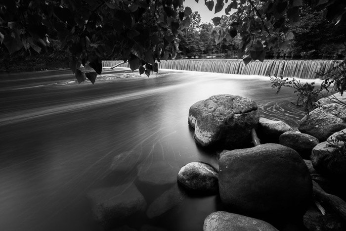 A black and white long exposure photo of Woodland creek in Catskills, New York.