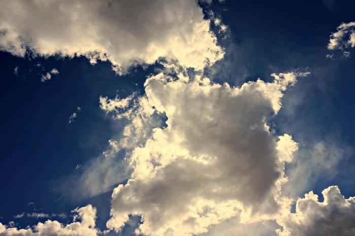 a photo of cumulus clouds against a blue sky