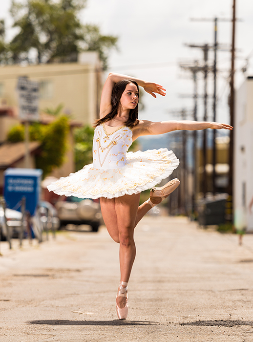 a bright and airy portrait of a ballerina dancing outdoors, poses for good profile pictures
