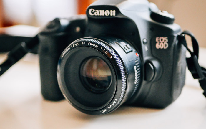 A Canon 60d DSLR on a table