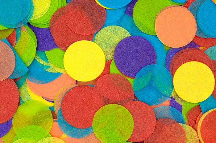 Coloured diy photography backdrops made from tissue paper cut into circles