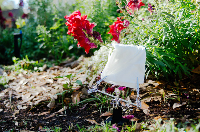 Shot of a white towel set up among flowers and plants for improved flower photos