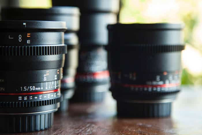 A variety of camera lenses on a table - full frame vs crop sensor
