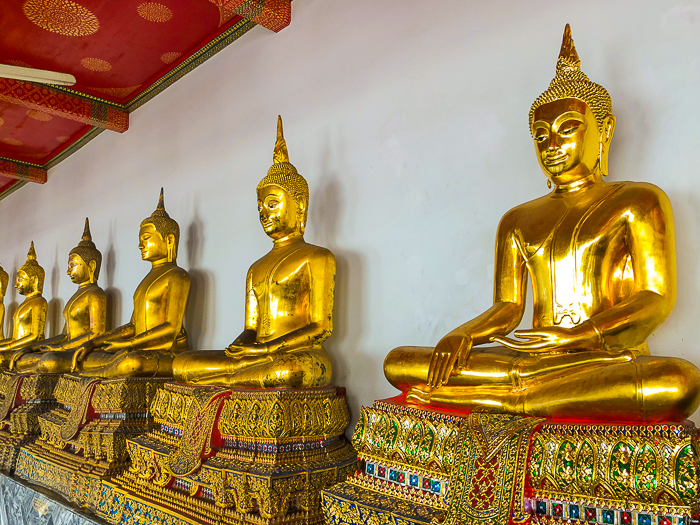 beautiful shot of Buddhist statues in Bangkok - how much to charge for photography