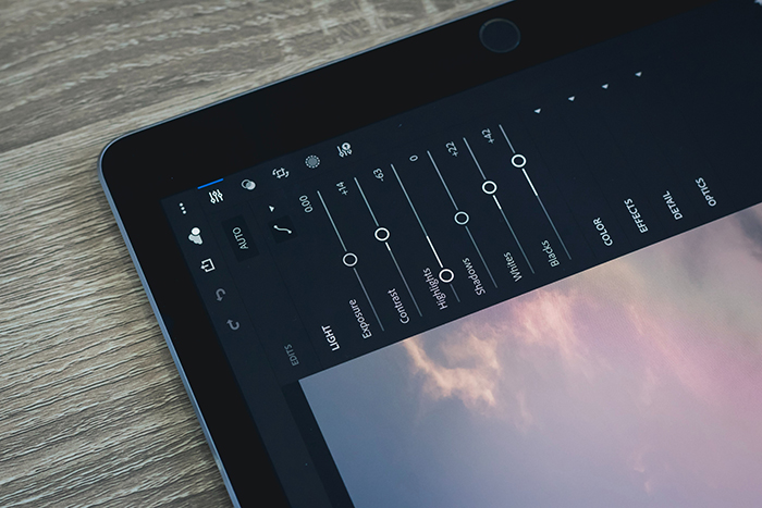 A close up of a tablet opened on Lightroom