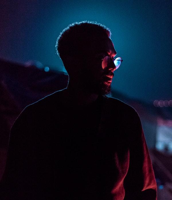 A night portrait of a man taken using a rim light