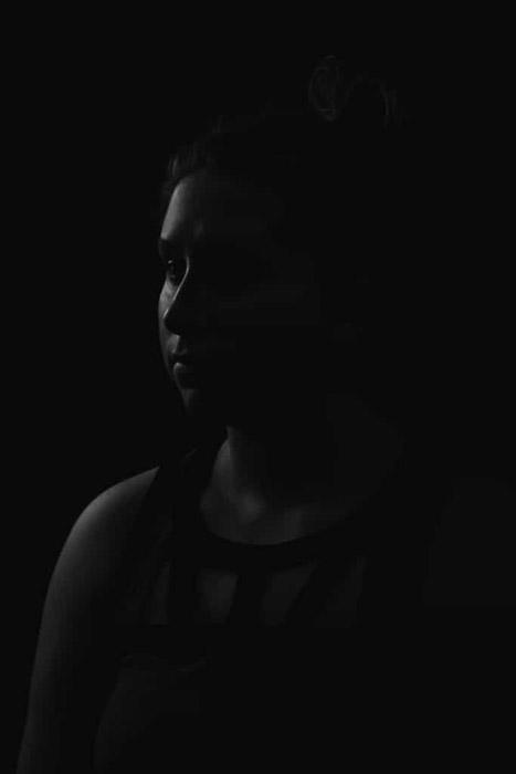 Atmospheric monochrome portrait of a female model shot using rim portrait lighting
