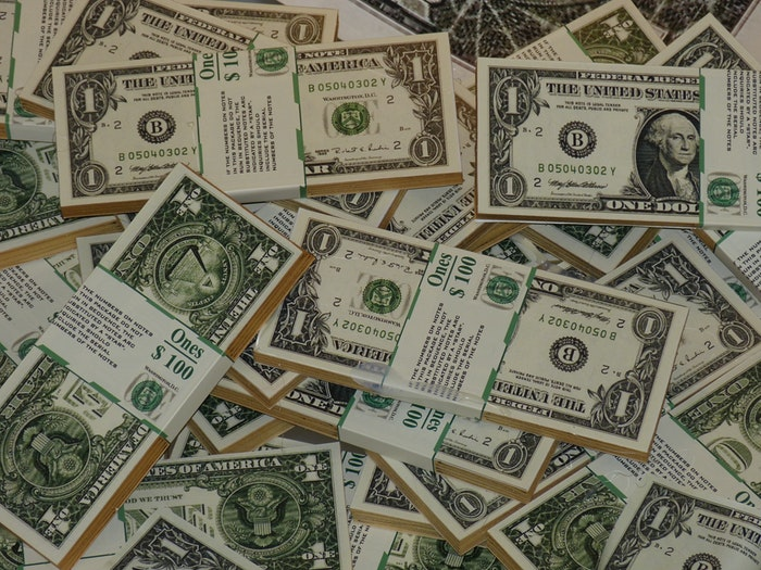 photo of a large stack of dollars