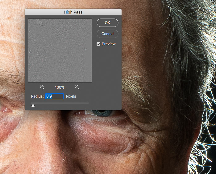 A screenshot of Photoshop with a photo of an older man in the background and the High Pass settings panel in the foreground