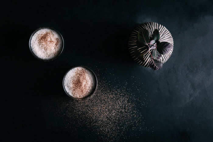 Dark and moody overhead food photo featuring two desserts