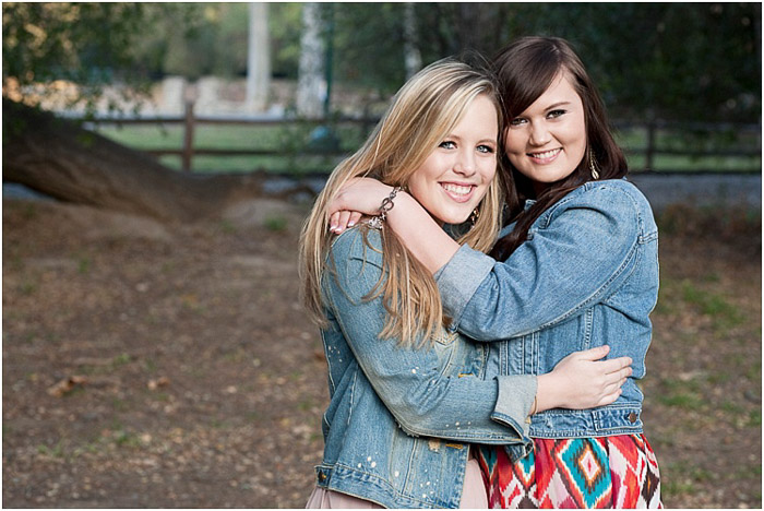 Sweet senior photography shot of best friends posing outdoors