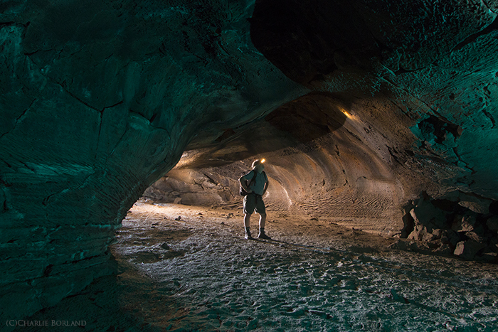 An adventure photographer cave Exploring, Central Oregon