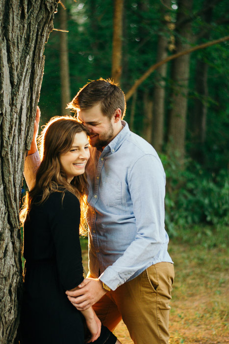 A couple kissing outdoors, shot using strobe photography