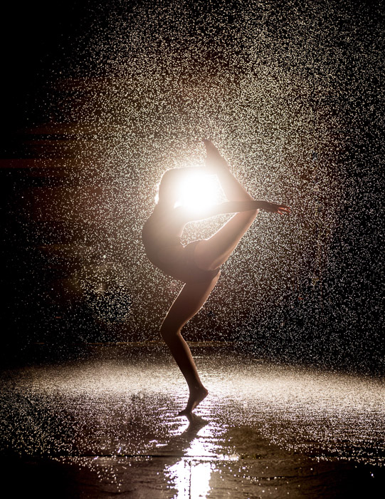 ballet dancer's silhouette photographed in the rain